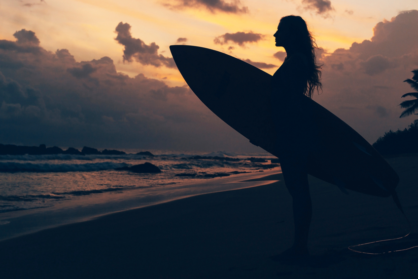 woman's solo surf travel trip