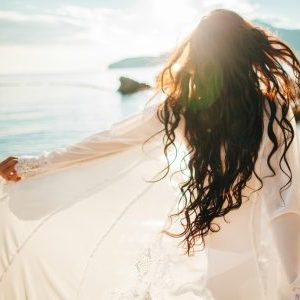 a woman's awakening solo travel beach meditation