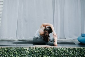 Bali Yoga Retreats yoga flow for reducing anxiety seated side stretch