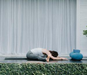 Bali Yoga Retreats yoga flow for reducing anxiety wide legged forward seated fold